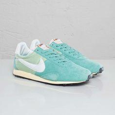Nike sneakers, had these but mine were dark green w/yellow nike sign