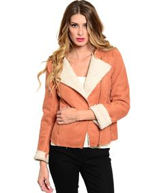Loving this beautiful faux suede shearling jacket.This moto style jacket features an oversized basic collar. Asymmetric zipped front closure. Faux fur lining. Zipped pocket accent.  S/M/L  100% poly