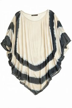 This beach ready poncho features a wide boat neckline, dolman sleeves and a v-shaped sweep at bottom hem.