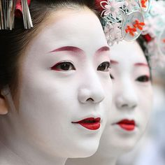 Geisha makeup - The traditional makeup of a maiko features a thick white base with red lipstick and red and black accents around the eyes and eyebrows.  The white base mask is made with rice powder.