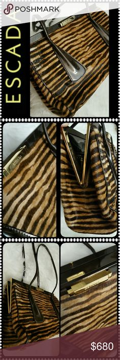 Escada Italy Leather Purse Escada Designer Bag, Soft Pony Hair Animal Print Design with Escada Gold Plate on Front and Inside Above Zippered Pocket, Made in Italy with Black Patent Leather Strap and Side Details with Gold Hardware, a Timeless Piece of Elegance Embodies this Purse!!!  Interior has Canvas Material with Zip Pocket and Gold Logo Zipper Pull and Escada Gold Plate,  Approx Size 10x7x3 inches with Strap Drop About 10 inches, Excellent Used Condition, Another Rare Find Could be…