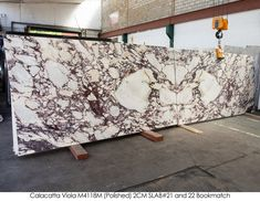 Our Calacatta Viola Bookmatched at the warehouse. Residential Interior Design, Calacatta, Hearth, Master Bathroom, Decorative Accessories, Granite, Light Fixtures, Kitchen Remodel, Living Room Decor