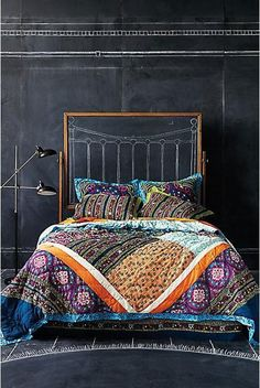 chaulk board head board. Interesting quilt layout with large patterned pieces of fabric