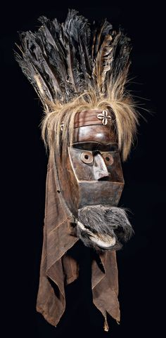 Africa | Landai initiation mask from the Poro society. Toma people of Guinea | Wood, textiles, feathers, fur, shells, natural fiber and metal