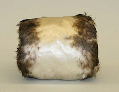 Muff Date: ca. 1900 Culture: American Medium: feathers, silk Dimensions: Length: 6 5/8 in. (16.8 cm) Credit Line: Gift of Anne L. Maxwell, in memory of her mother, Julia H. Lawrence, 1989 Accession Number: 1989.246.13