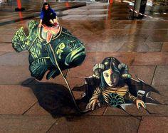 Художница из Италии Вера Бугатти (Vera Bugatti) создает трехмерные картины на социальную тематику прямо на улицах города. Также персонажей для своих картин она берет из книг, так как кроме художественной деятельности работает библиотекарем.