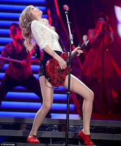 Taylor Swift performing red.