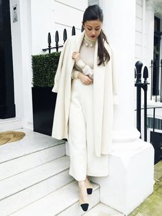 On Peony Lim: Joseph Transparent Roll Neck Knit(£125); CO culottes; Chanel shoes.