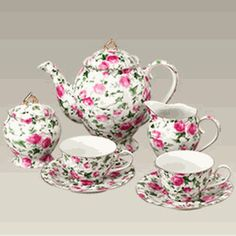 Small red roses with lots of greenery on white background tea service set