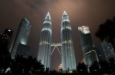 The Petronas towers before and (click or tap to view) after the lights were switched off during the Earth Hour campaign in Kuala Lumpur on March 19, 2016. <strong>[<em>Click or tap the image to view transition</em>.]</strong>