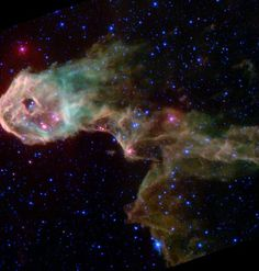 This archival image from 2003 captured by NASA's Spitzer Space Telescope captured the Elephant's Trunk Nebula, an elongated dark globule within the emission nebula IC 1396 in the constellation of Cepheus.