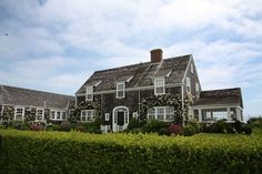 I'm SWOONING ! ! ! - natural exterior Cape Cod house, covered porch on one side, addition on the other