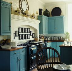 turquoise kitchen cabinets, cream walls, wood countertops. Would look great with black and white checkered floor!