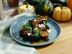 Get Herb-Roasted Acorn Squash with Queso Fresco and Pomegranate Recipe from Food Network