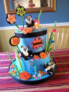 Birthday Cakes - Birthday cake for 13 year old girl who loves pandas.  Top tier is a double barrel 10 inch cake - 3 layers carrot with cream cheese, 3 layers buttermilk chocolate with cream cheese - covered in fondant.  Bottom tier is a 12 inch dummy.  Pandas are fondant and modeling dough.  Everything is edible except ribbon.