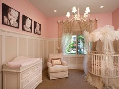 Cute nursery in pink with baby pictures on the wall adding a personal touch