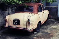 Rusty Old Car in India Stock Photo