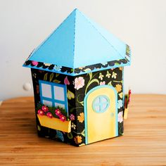 Delightful Dwelling Birdhouse | Paper Garden Projects  Digital cutting file for a birdhouse shaped gift box.