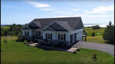 Waterview Luxury Home in PEI! 4645 South Shore Road, Nine Mile Creek, Prince Edward Island Real Estate Marketing Companies, Gate Way, Real Estate Video, Built In Bookcase, Prince Edward Island, Real Estate Photography, Custom Cabinetry, Patio Doors, Luxury Homes
