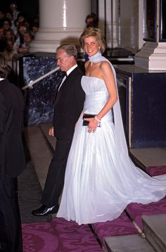Diana, Princess of Wales wearing a full length white ball grown leaving a West End Show in London. 1989.