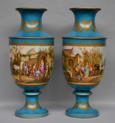 Lot 820: A pair of French polychrome Sèvres vases, decorated with animated scenes, 19thC, H 81 cm (one vase with restoration on the base)  € 1.500 - € 2.500