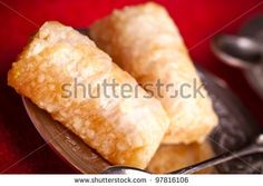 Sold at Shutterstock: Finger baklava is a traditional ottoman dessert made by  tightly rolled fillo dough stuffed with ground cashew. by eZeePics Studio, via ShutterStock