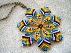 Macrame flower pendant done in the mandala flower technique, with 7 petals and 7 colors