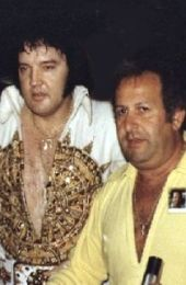 """Joe Esposito with Elvis at the Last Concert 1977. Joe met Elvis while they were both in the army. Joe was Elvis' aide and right hand man from 1960-1977. They cemented their friendship while stationed in West Germany. Elvis gave him the martial-arts nickname, """"The Lion"""". After Elvis returned to the US, he hired Esposito as his road manager."""