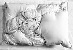 Iranian artist Maryam Ashkanianembroiders individuals deep in sleep onto the surface of her handmade pillows, matching the size of her subjects to the area one would physically occupy if they took a nap on her work. The stitched sleepers lay sprawled in different configurations on the white backgro