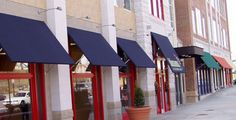Many companies are now using a mix of canvas and metal awnings on their storefronts.