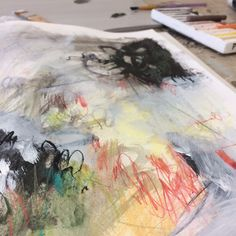 Using intuitive mark making and colour choices within a sketchbook to generate ideas for painting