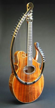 """This lyra harp allows a harp guitarist to play two instruments like a standard guitar to create a deeper melody. (Photo: Worland Guitars) """"I know it's not a mandolin, but look at it. Guitar Art, Music Guitar, Cool Guitar, Guitar Tips, Ukulele, Sound Of Music, Music Is Life, Soul Music, Beautiful Guitars"""