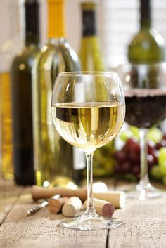 Glass of white wine with bottles in background by Sandra Cunningham - Holiday, Wine - Stocksy United White Wine Grapes, White Zinfandel, Wine Photography, Photography Ideas, French Wine, Wine Art, Wine O Clock, Italian Wine, Wine And Beer