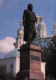 """Monument of M. Kutuzov. Sculptor G. I. Motovilov, architect L. M. Poliakov. The monument is disposed in the public garden in the beginning of the Sovietskaya street, and it was installed in 1954. You can see the bronze figure of M. Kutuzov (4 m) in classical pose with sword in his right deflated hand on the granite pedestal by height 3.15 m. On card face of the pedestal there is a board with the inscription: """"To the great russian military leader Mikhail Illarionovich Kutuzov, prince Smolenskij"""" Public Garden, Monuments, Pedestal, Granite, Statue Of Liberty, Sword, Prince, Military, Poses"""