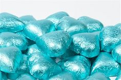 Tiffany Blue Foiled Milk Chocolate Hearts (1 Pound Bag)  92.10 for 10 lbs which is 540 pieces. Could go in boxes! Or on sweets table...