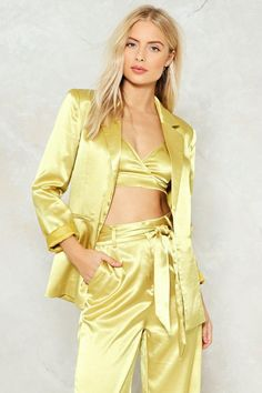 All the honeys, who making money, throw your hands up at me. The Independent Women Blazer comes in satin and features notched lapels, two front pockets, structured design, and tie closure at waist. Pair with the Independent Women Bra Top or Independent Women Pants.