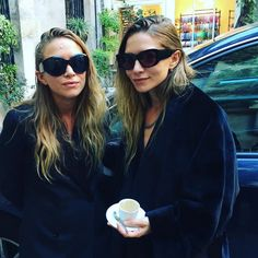 Pin for Later: The Olsens Just Made Their PFW Debut With a Stunning (and Superintimate) Presentation The Twins Wore Black Coats and Cat-Eye Sunglasses For the Show They also sipped on espresso.