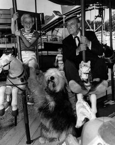 Buster rides the carousel with child actor Jay North (Dennis the Menace) 1961