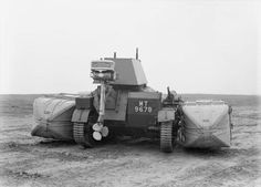 A4  Vickers Light Tank Mk IIa with floatation tanks and outboard motor. 1930s