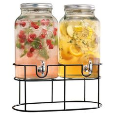 Serve sweet sangria or fresh lemonade in style with this 2-jug beverage dispenser, showcasing a jar-inspired design.  Product: 2...