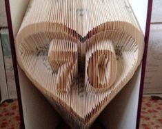 "Book folding pattern for ""70 in a heart outline"" +FREE TUTORIAL"