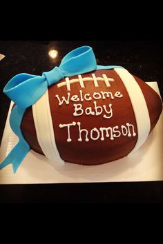 Baby boy football shower cake:  Well, I certainly can't make it, but it's cute.