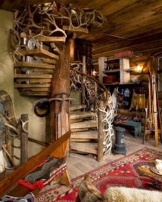 The three-story staircase (with an elk-antler banister, naturally) wraps around a giant tree. #Jetsetter