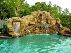 Exquisite pool with rock waterfall and slide.