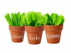 Forks, knives, and spoons in flower pots