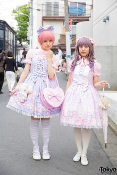 Hikachimu(right) 16, wearing a pastel pink and purple Angelic Pretty dress with a pastel pink heart shoulder bag, white tights, and white Baby, The Stars Shine Bright patent leather Mary Janes. Ayuta(left) 16, pastel pink blouse and lavender print JSK with matching katyusha are from Angelic Pretty, worn with white cross-strap Honey Bee shoes. She's carrying both a My Melody plush bag and a pink heart-shaped with bows shoulder bag from Angelic Pretty.