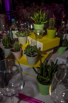 Who said a centerpiece could only be one statement item? Stack a few brightly colored books and top them off with some fun succulent plants to truly make a statement! Succulent Plants, Planting Succulents, Potted Plants, Succulent Centerpieces, Simple Centerpieces, Conkers, Some Fun, Bright Colors, Event Planning