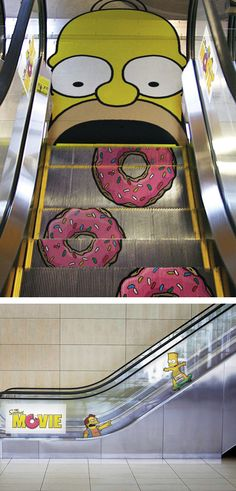 This great escalator was made for The Simpsons movie. It features everyone's favorite dolt chomping down on donuts at the bottom of the escalator. What did you expect? Homer Simpson eating a veggie burger? This advertising piece was done by Gabriel Russo.
