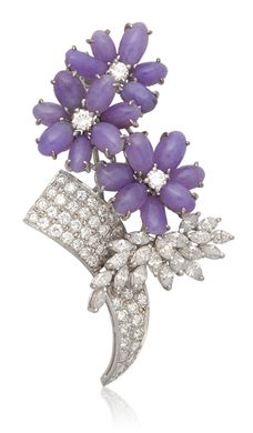 A LAVENDER JADEITE AND DAIMOND BROOCH.  Items which contain rubies or jadeite originating in Burma (Myanmar) may not be imported into the U.S. This is one such item