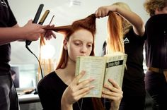 Codie Young checks out with a book.  Photographed by Anna Moller